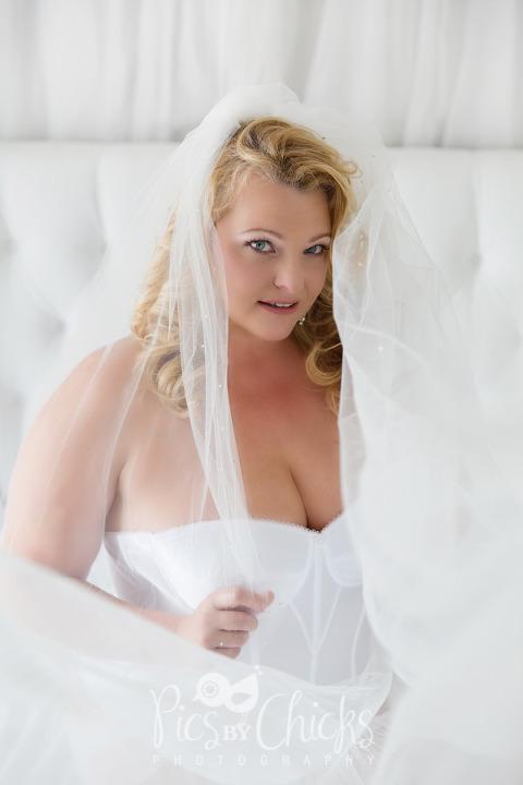 plus size boudoir bridal photo session in white lingerie
