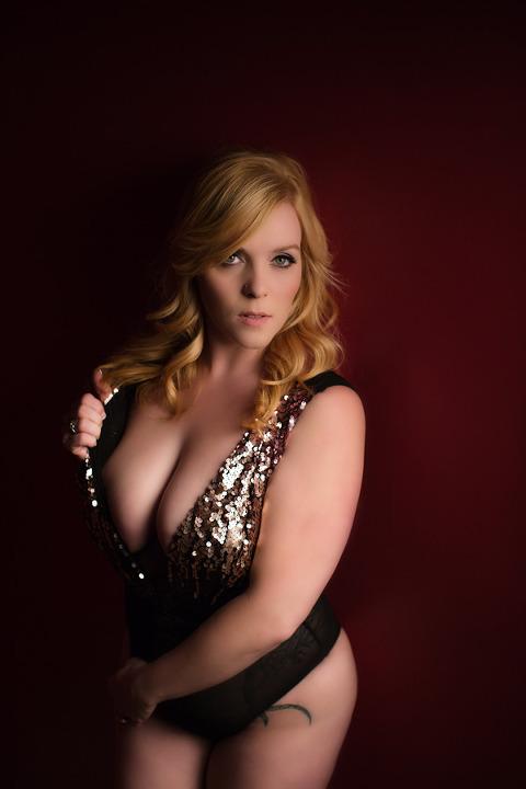 woman in sequin bodysuit in boudoir photo shoot pittsburgh