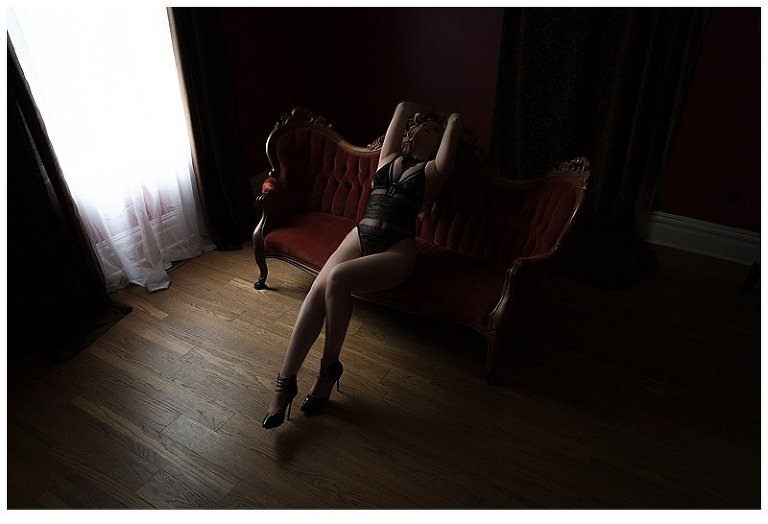 boudoir photography pittsburgh woman in Asos bodysuit on Victorian sofa by Pics by Chicks Photography