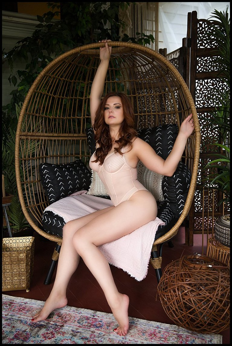 pittsburgh boudoir photography of woman in nude bodysuit in egg chair