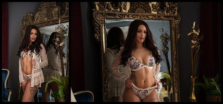 boudoir photos pittsburgh of woman in floral lingerie posing in front of grand mirror