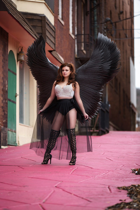 boudoir photography pittsburgh with black wings in city photo shoot
