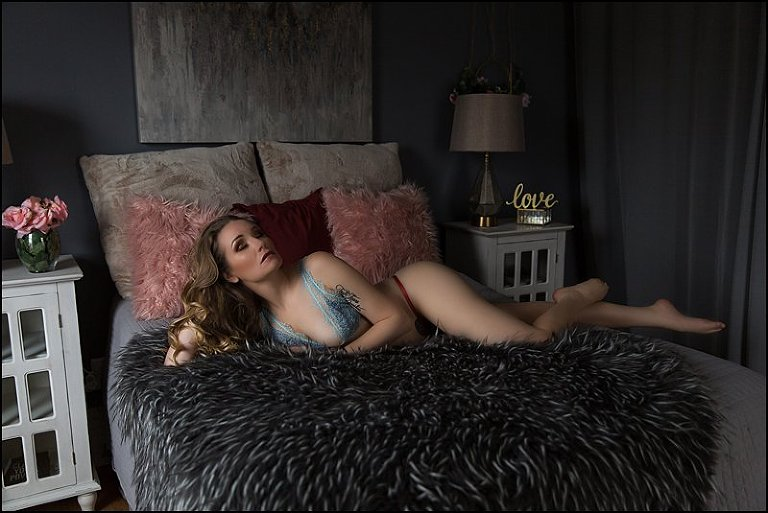 boudoir photos pittsburgh woman laying on bed in bra and panty