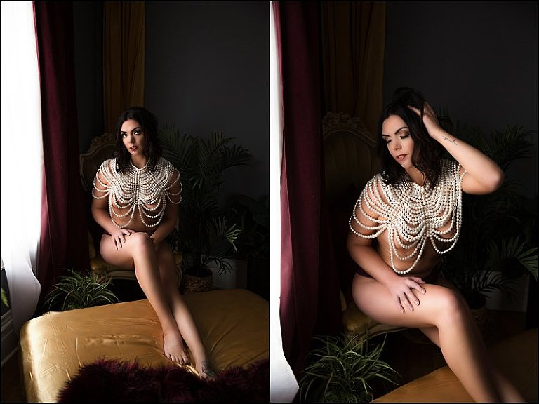 boudoir photo shoot on gold sheets with maroon blanket