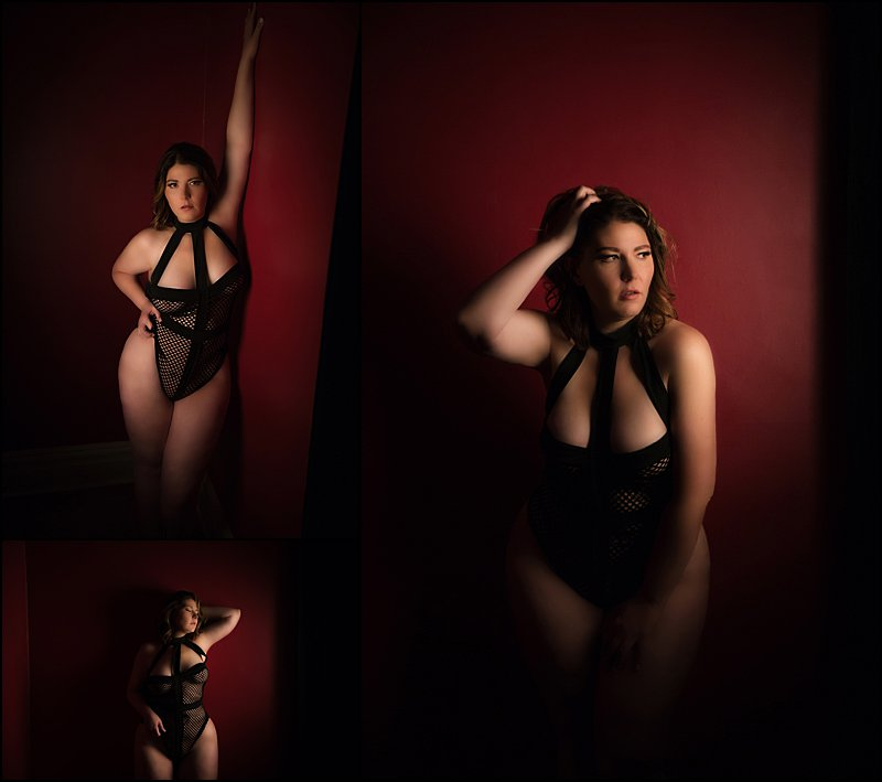 boudoir photo shoot pittsburgh, boudoir photography with Maura Chick, in studio boudoir photos woman in black fishnet lingerie posing on red wall